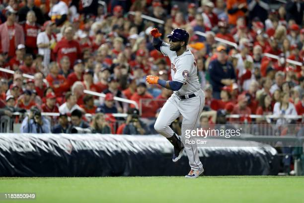 Yordan Alvarez of the Houston Astros celebrates as he hits a tworun home run against the Washington Nationals during the second inning in Game Five...