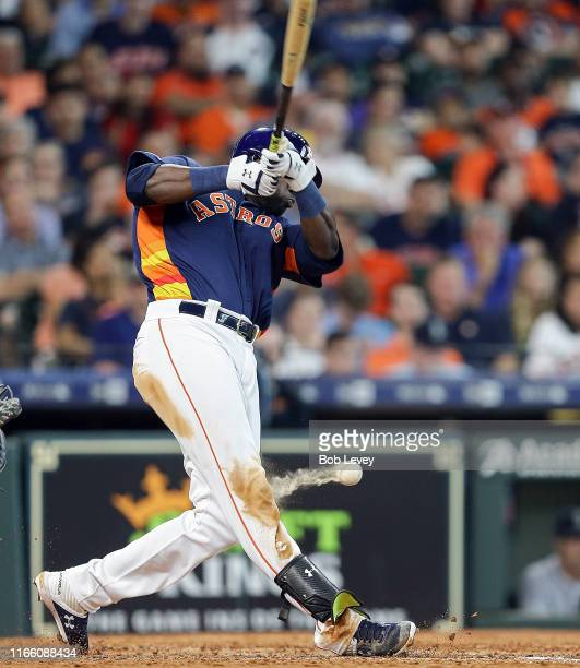 Yordan Alvarez of the Houston Astros fouls the ball off his knee in the sixth inning against the Seattle Mariners at Minute Maid Park on August 04,...