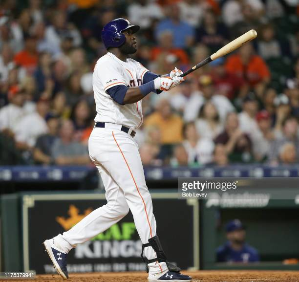 Yordan Alvarez of the Houston Astros hits a home run in the sixth inning against the Texas Rangers at Minute Maid Park on September 17 2019 in...