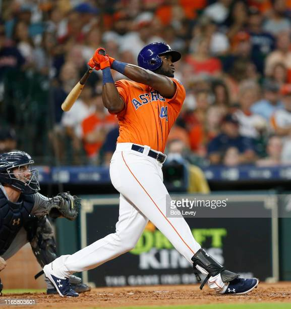 Yordan Alvarez of the Houston Astros hits a home run to center field in the second inning against the Seattle Mariners at Minute Maid Park on August...