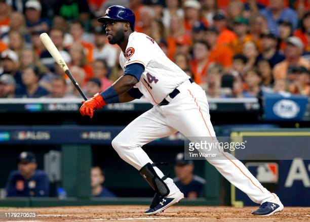 Yordan Alvarez of the Houston Astros hits a single against the Tampa Bay Rays in the second inning of Game 2 of the ALDS at Minute Maid Park on...