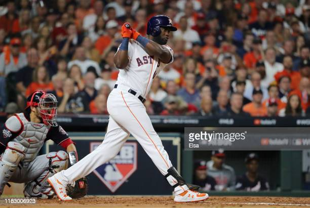 Yordan Alvarez of the Houston Astros hits a single against the Washington Nationals during the fourth inning in Game Two of the 2019 World Series at...