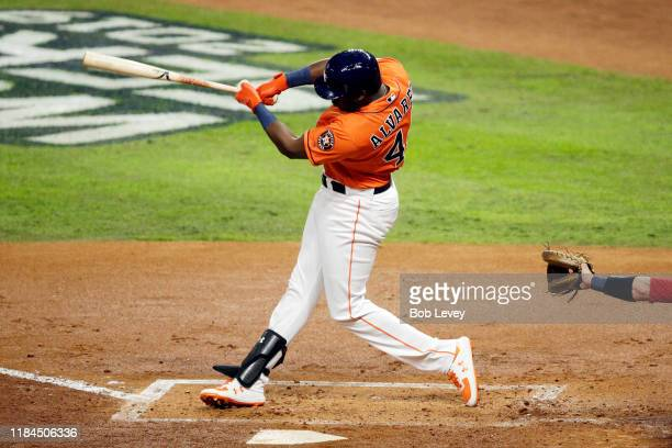 Yordan Alvarez of the Houston Astros hits a single against the Washington Nationals during the second inning in Game Seven of the 2019 World Series...