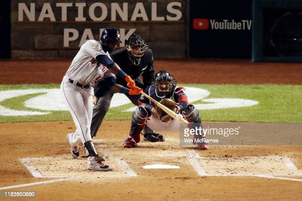 Yordan Alvarez of the Houston Astros hits a two-run home run against the Washington Nationals during the second inning in Game Five of the 2019 World...