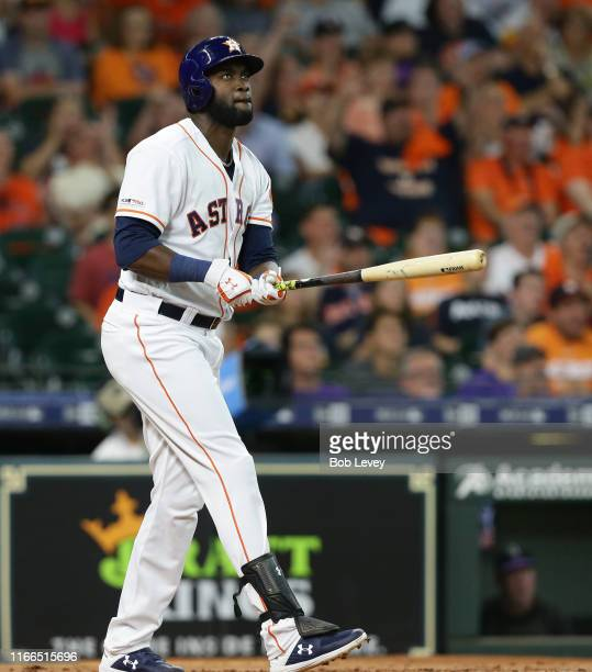 Yordan Alvarez of the Houston Astros hits a tworun home run in the second inning against the Colorado Rockies at Minute Maid Park on August 06 2019...
