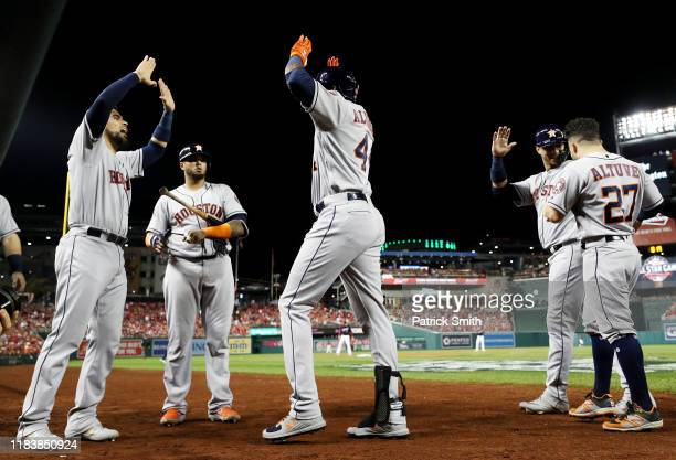 Yordan Alvarez of the Houston Astros is congratulated by his teammates after hitting a two-run home run against the Washington Nationals during the...