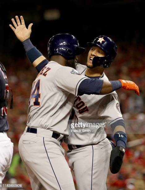 Yordan Alvarez of the Houston Astros is congratulated by his teammate Yuli Gurriel after hitting a two-run home run against the Washington Nationals...