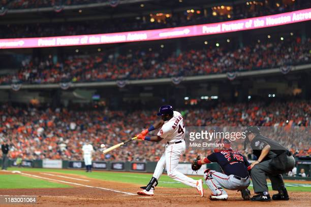 Yordan Alvarez of the Houston Astros lines out against the Washington Nationals during the second inning in Game Two of the 2019 World Series at...