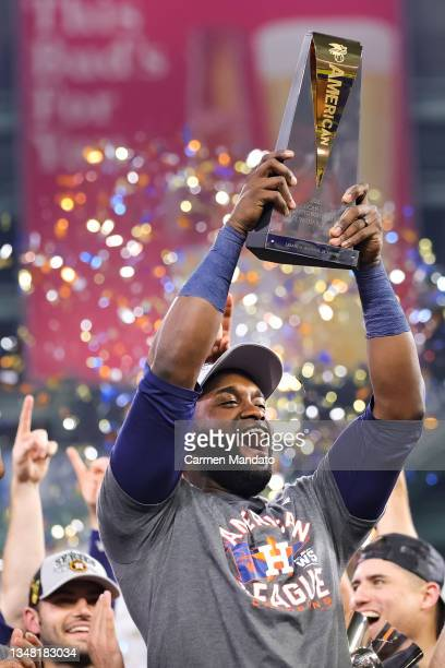 Yordan Alvarez of the Houston Astros raises the League Championship Series Most Valuable Player Award after defeating the Boston Red Sox 5-0 in Game...