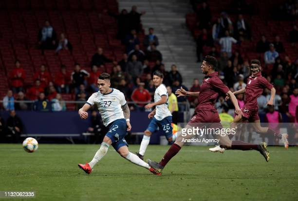 Yordan Osorio of Venezuela in action against Lautaro Martinez of Argentina during the Friendly match between Argentina and Venezuela at Wanda...