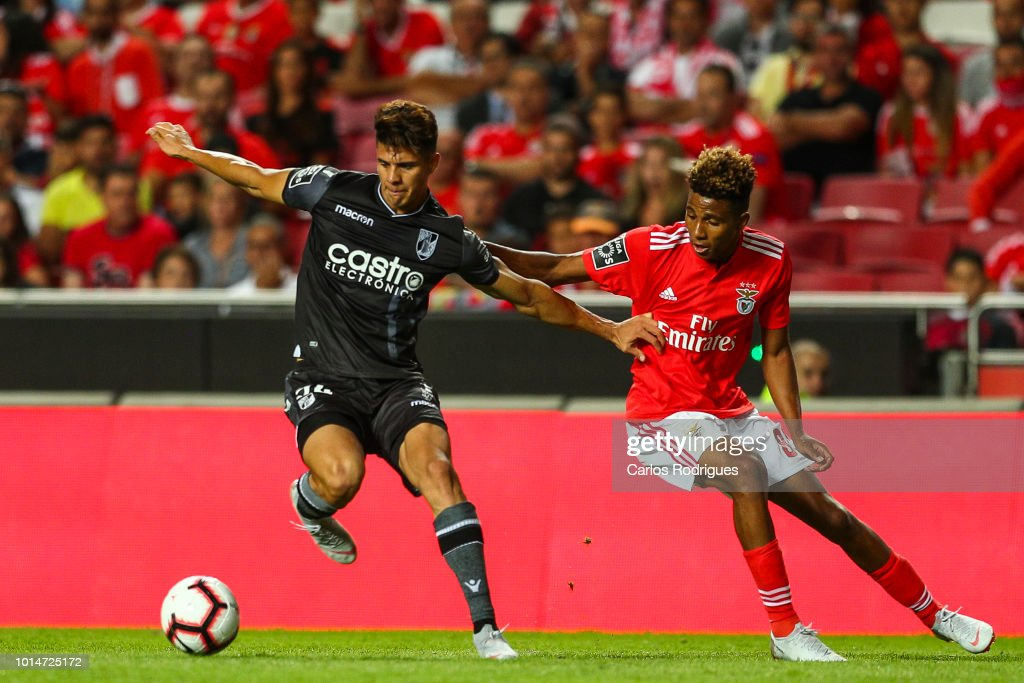 Yordan Osorio of Vitoria SC (L) vies with Gedson Fernandes of SL Benfica (R) for the ball possession during the Liga NOS match between SL Benfica and Vitoria SC at Estadio da Luz on August 10, 2018 in Lisbon, Portugal.