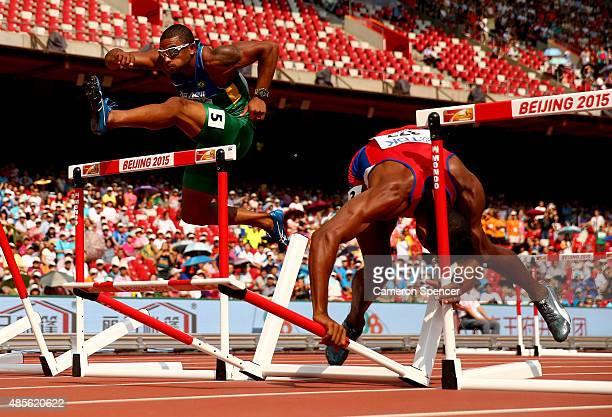 Yordani Garcia of Cuba falls next to Felipe Dos Santos of Brazil in the Men's Decathlon 110 metres hurdles during day eight of the 15th IAAF World...