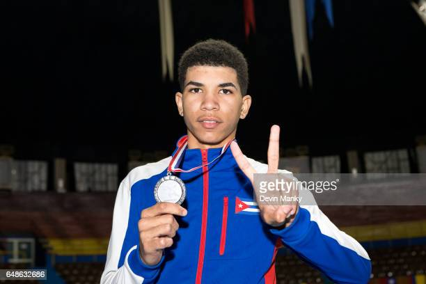 Yordano De La Caridad Suarez Santiuste of Cuba poses with his silver medal won during competition in the Junior Men's Epee competition at the Cadet...