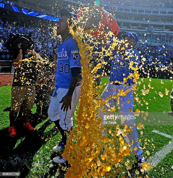Yordano Ventura of the Kansas City Royals is doused with Gatorade by Salvador Perez after Ventura threw a complete game in the Royals' 8-3 win over...
