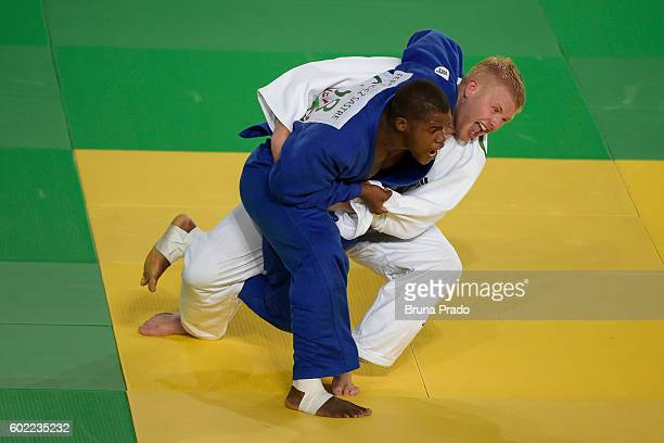 Yordany Sastre of Cuba battles with Christopher Skelley of Great Britain during the Men 100kg Judo Bronze Medal on Day 3 of the Rio 2016 Paralympic...