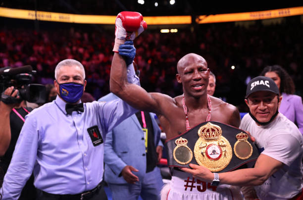 Yordenis Ugas poses with referee Russell Mora after defeating Manny Pacquiao in a WBA welterweight title fight at T-Mobile Arena on August 21, 2021...