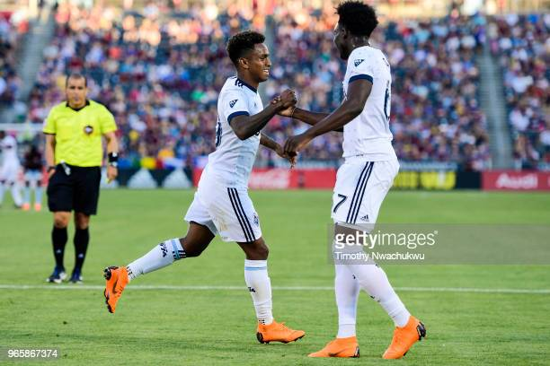 Yordi Reyna and Alphonso Davies of Vancouver Whitecaps celebrate Reyna's goal against the Colorado Rapids at Dick's Sporting Goods Park on June 1...