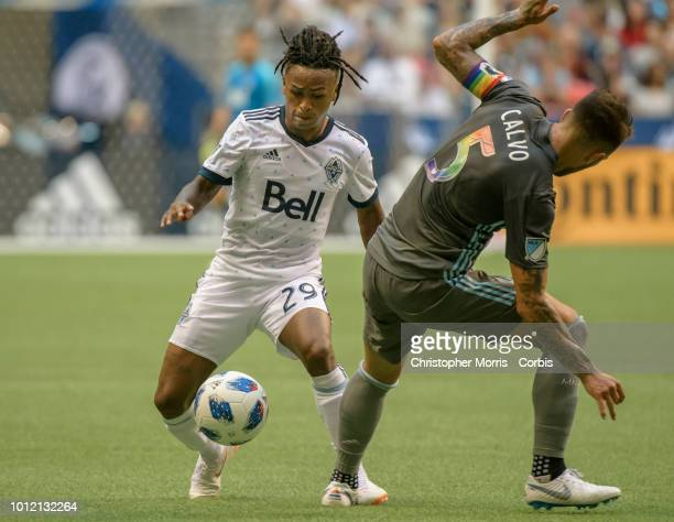 Yordi Reyna of the Vancouver Whitecaps and Francisco Calvo of Minnesota United compete for the ball at BC Place on July 28, 2018 in Vancouver, Canada.
