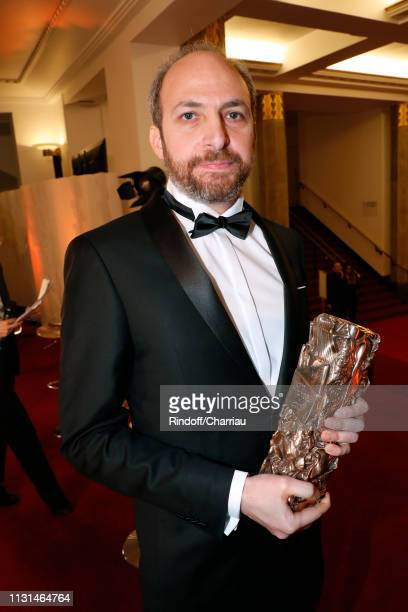 """Yorgos Lamprinos, winner of the award for Best Editing for """"Jusqu'a la garde"""" poses during the Cesar Film Awards 2019 at Salle Pleyel on February 22,..."""