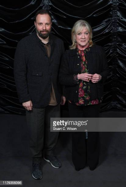 Yorgos Lanthimos and Ceci Dempsey attend The Favourite London QA at Twentieth Century Fox on February 12 2019 in London England