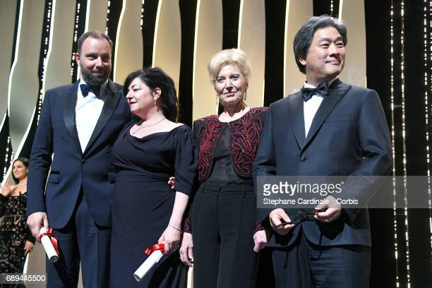 Yorgos Lanthimos and Lynne Ramsey pose with their awards for Best Screenplay for the movies 'The Killing Of A Sacred Deer' and 'You Were Never Really...