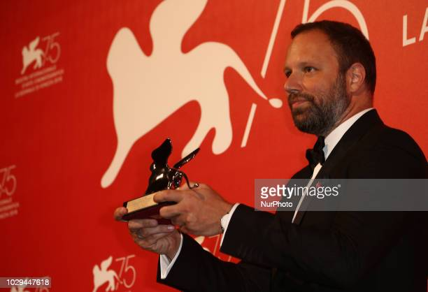 Yorgos Lanthimos poses with the Silver Lion Grand Jury Prize for 'The Favourite' at the Winners Photocall during the 75th Venice Film Festival on...