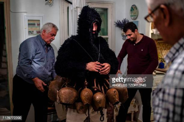 Yorgos Mavrikos dressed in a costume of ''Old man prepares to take part in the Skyrian Carnival on the island of Skyros northeast of Athens on March...