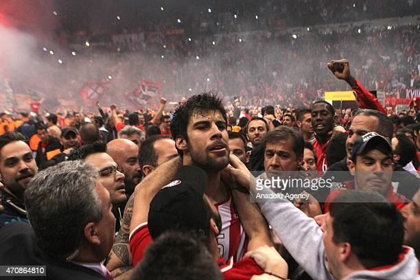 Yorgos Printesiz of Olympiacos celebrates the score with fans during the Turkish Airlines Euroleague Basketball Play Off Quarter Final Game 4 between...