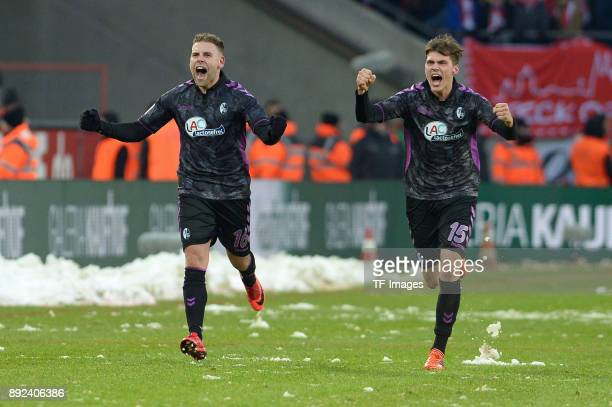 Yoric Ravet of Freiburg and Pascal Stenzel of Freiburg celebrate their team`s fourth goal during the Bundesliga match between 1 FC Koeln and...