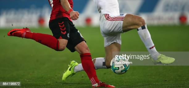 Yoric Ravet of Freiburg is challenged by Kyriakos Papadopoulos of Hamburg during the Bundesliga match between SportClub Freiburg and Hamburger SV at...
