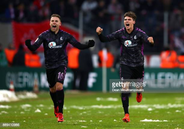 Yoric Ravet of SC Freiburg and Pascal Stenzel of SC Freiburg celebrate after the Bundesliga match between 1 FC Koeln and SportClub Freiburg at...