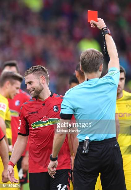 Yoric Ravet of SC Freiburg getting red card from Referee Benjamin Cortus during the Bundesliga match between Sport Club Freiburg and Borussia...