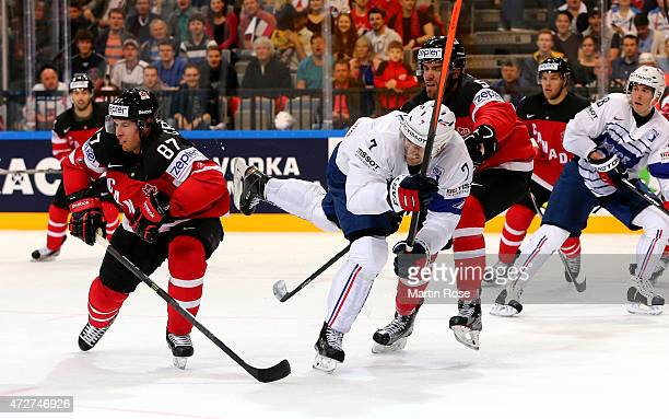 Yorick Treille of France and Aaron Ekblad of Canada battle for the puck during the IIHF World Championship group A match between France and Canada at...