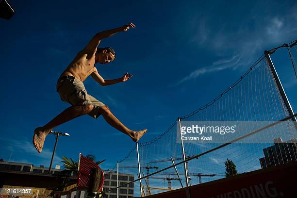Yorin performs on a slackline at the East Side Beach on August 20 2011 in Berlin Germany Berlin which is among Europe's most popular travel...