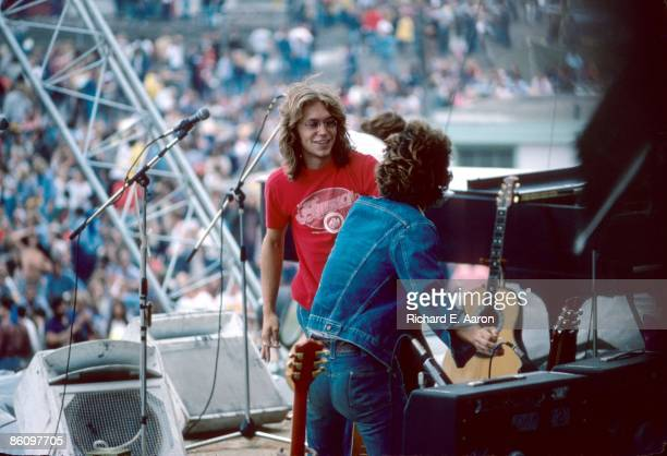 Gerry Beckley and Dan Peek from folk rock band America perform live on stage in Central Park New York on 24th August 1975