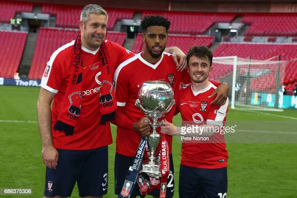 York City goalscorers Jon Parkin Vadaine Oliver and Aiden Connolly pose with the Trophy at the end of The Buildbase FA Trophy Final between York City...
