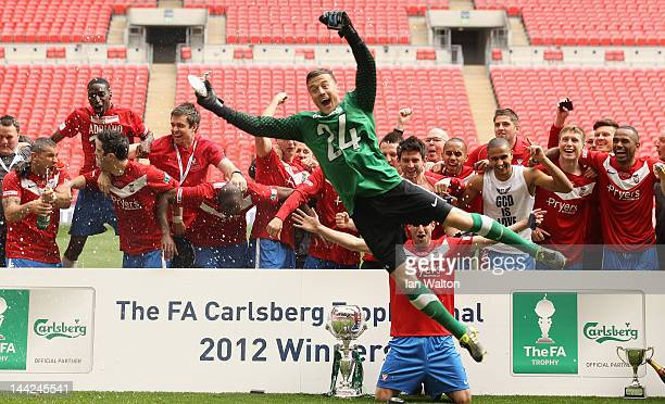 York City players celebrates with the trophy after winning the FA Trophy Final match between York City and Newport County at Wembley Stadium on May...