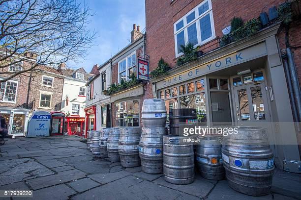 York city street scene in United Kingdom with beer pub