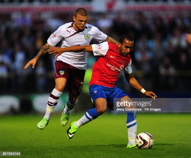 York City's Ashley Chambers and Burnley's Kieran Trippier in action during the Capital One Cup First Round match at Bootham Cresent York