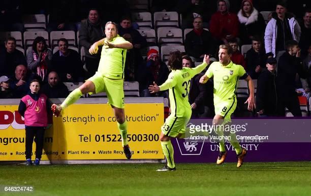 York City's Jon Parkin celebrates scoring the opening goal during the Vanarama National League match between Lincoln City and York City at Sincil...