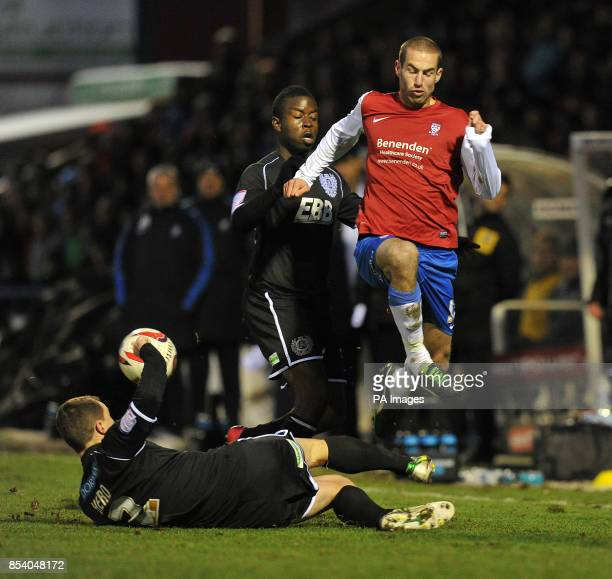 York City's Matty Blair is tackled by Aldershot Town's Ben Herd and Kieron Cadogan during the npower League Two match at Bootham Crescent York