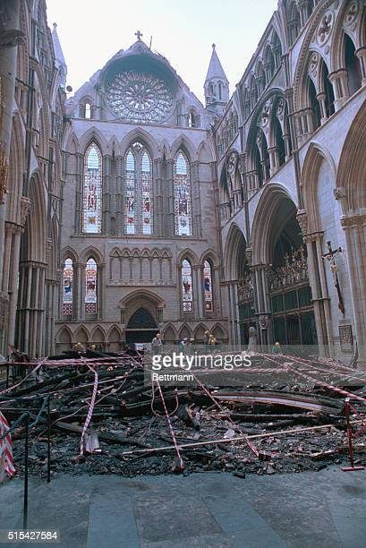 A stone figure seems to add tranquility to the chaos of rubble inside York Minster England July 9th after an early hours fire caused a section of the...