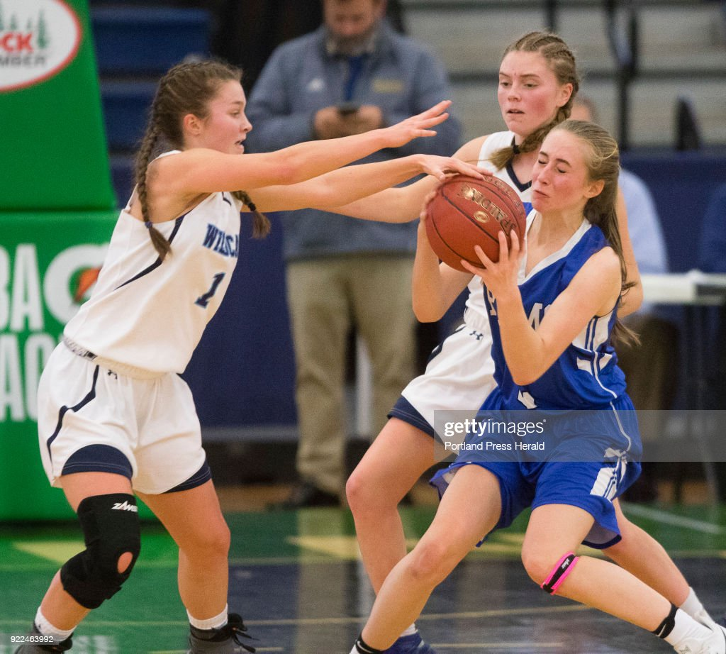 York guard Nina Howe tries to steal the ball from Kennebunk guard Jessica Dupler during the Maine Class A South quarterfinals on Monday, February 19, 2018 at the Portland Expo. York forward Kristen Leroux looks on from behind.