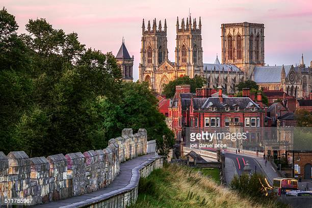 york minster and city wall, england - york minster stock photos and pictures