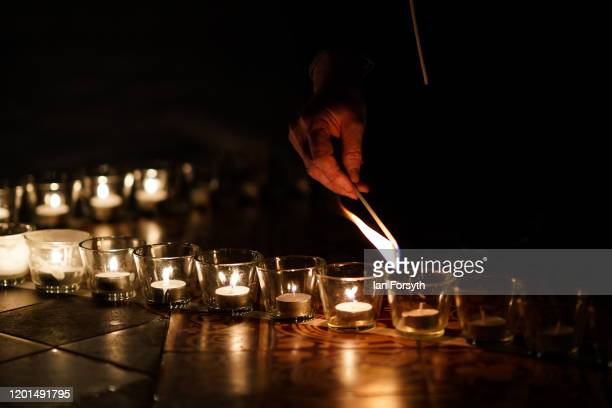 York Minster staff light some of the 600 candles shaped as a Star of David and set out on the floor of the Chapter House of York Minster as part of a...