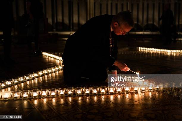 York Minster staff light some of the 600 candles shaped as a Star of David set out on the floor of the Chapter House of York Minster as part of a...