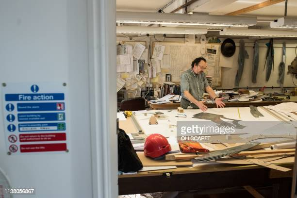 York Minster's Master stonemason John David works in his office above the Minster's Stoneyard in York northern England on April 18 2019 The stories...