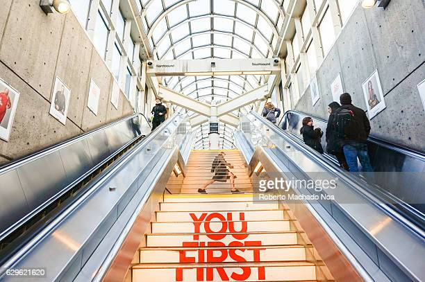 Upward view of stairs in a huge mall with elegant glass ceiling Escalators on both sides