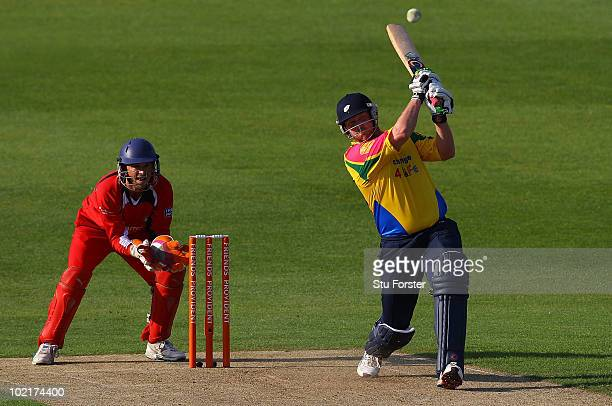 Yorkshire batsman Anthony McGrath hits a six watched by Lancashire wicketkeeper Gareth Cross during the Friends Provident T20 match between Yorkshire...