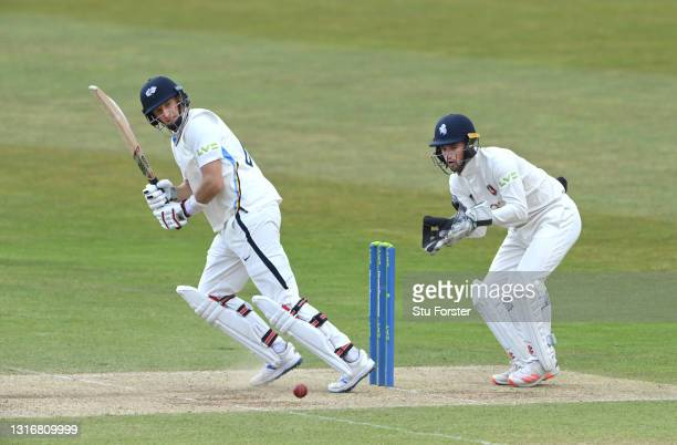Yorkshire batsman Joe Root picks up some runs watched by wicketkeeper Ollie Robinson during day two of the LV= Insurance County Championship match...